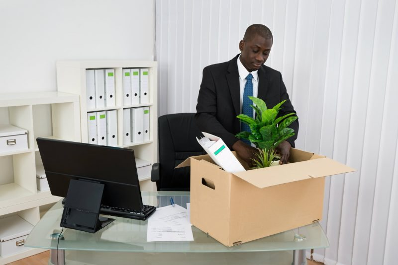 Man clearing his desk