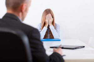 Woman being fired by boss