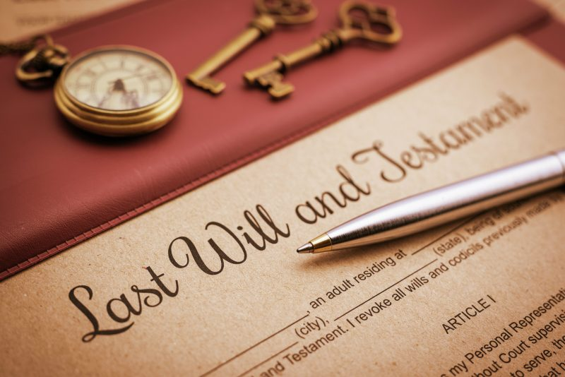 last will with pen and watch
